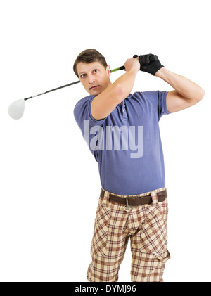 Photo of a male golfer in his late twenties finishing his swing with a driver. - Stock Photo