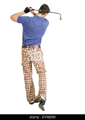 Photo of a male golfer in his late twenties finishing his swing with a wedge. - Stock Photo