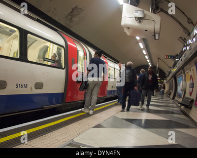 Passengers waiting for the doors to open on a London Underground Northern line train at Waterloo station. - Stock Photo