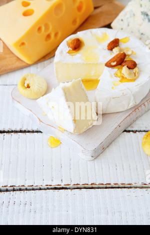 mixed cheese with honey, food closeup - Stock Photo