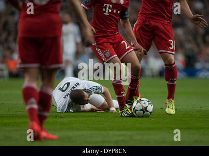Madrid, Spain. 23rd Apr, 2014. Real Madrid's Karim Benzema (Bottom) falls to the ground during the UEFA Champion - Stock Photo