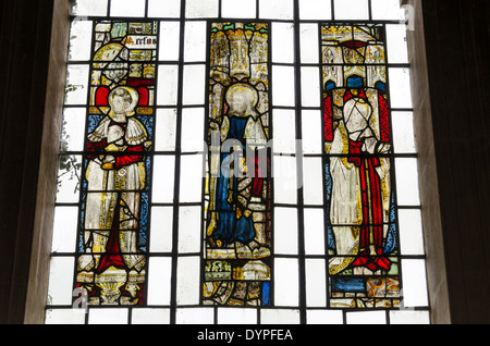 Medieval stained glass window in St Mary church Temple Guiting - Stock Photo