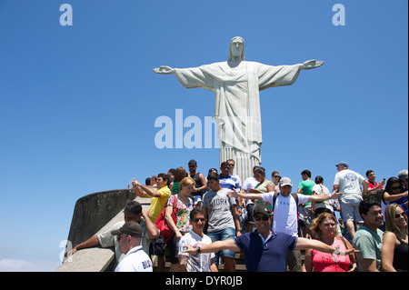 RIO DE JANEIRO, BRAZIL - OCTOBER 20, 2013: Tourists posing for pictures on the viewing platform at the statue of - Stock Photo