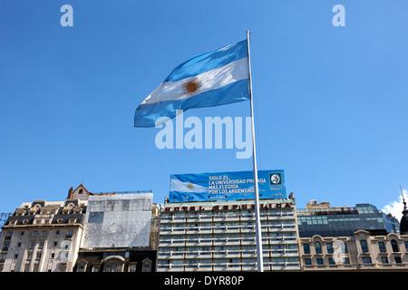argentine flag flying in plaza republica on avenida 9 de julio Buenos Aires Argentina - Stock Photo
