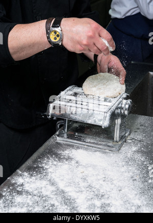 Making Tortellini pasta Kneading the dough - Stock Photo
