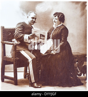 Old portrait of marriage. Vintage. Aged copy. 1914s. Studio portrait. The sepia toning. - Stock Photo
