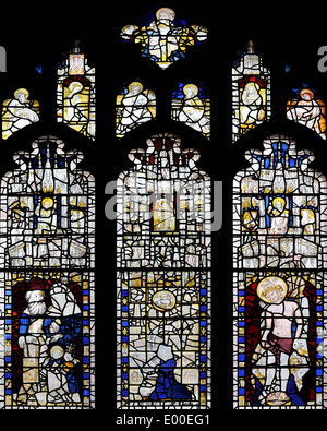 A reset Medieval stained glass window in the south wall of the Church of Saint Martin-le-Grand, Coney Street, York, - Stock Photo