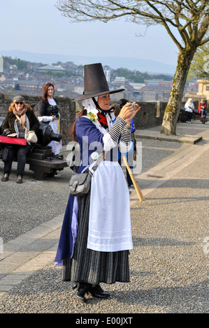Welsh woman in traditional costume attending the six Celtic nation's parade in Londonderry city centre. - Stock Photo