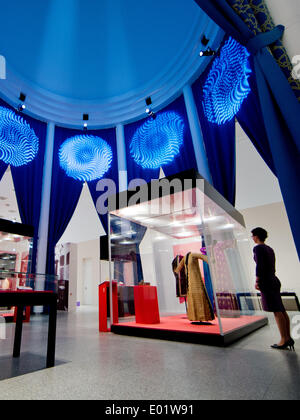 Bonn, Germany. 29th Apr, 2014. A museum employee looks at Turkish women's caftans from 19th century in the exhibition - Stock Photo