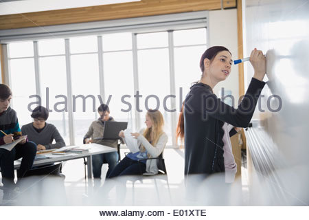 High school student at whiteboard in classroom - Stock Photo