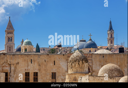 Belfries and domes of christian churches and minarets of mosques under blue sky in Jerusalem, Israel. - Stock Photo