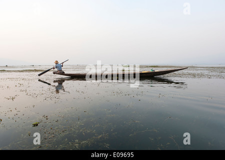 South East Asia Myanmar Burma Shan State Nyaung shwe Lake Inle Intha leg rowing fishermen at dusk sunset the fisherman - Stock Photo