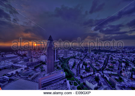 Germany, Hesse, Frankfurt am Main, Trade Fair Tower and city view at sunset - Stock Photo