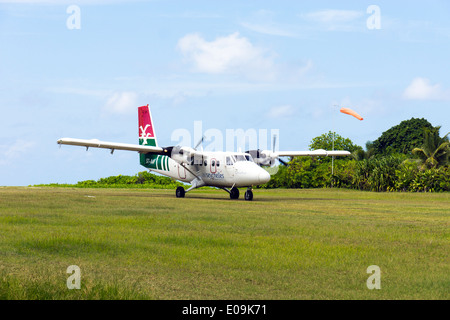Seychelles, Northern Coral Group, Denis Island, DHC6 Twin Otter 300 on runway, departure - Stock Photo