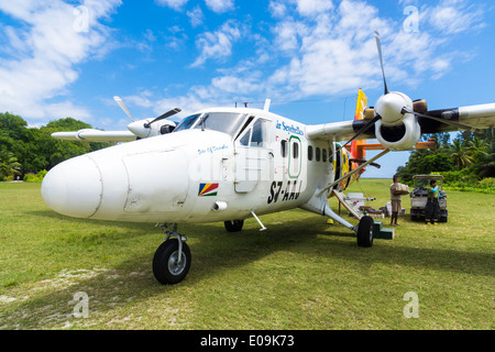 Seychelles, Northern Coral Group, Denis Island, DHC6 Twin Otter 300 after landing - Stock Photo