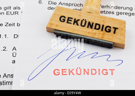 A stamp of wood lies on a document. German label: discontinued, Ein Stempel aus Holz liegt auf einem Dokument. Deutsche - Stock Photo