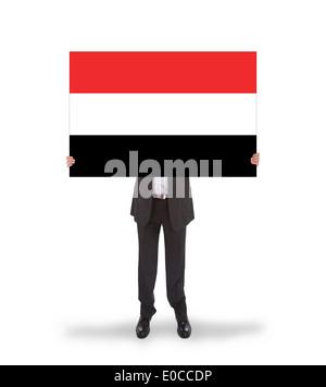 Businessman holding a big card  flag of Yemen  isolated on white - Stock Photo