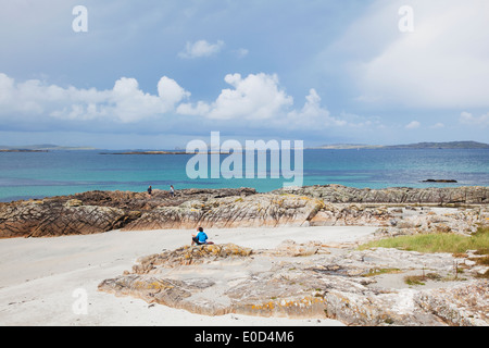 A beach near Cleggan with Inishbofin Island in the distance; County Galway, Ireland - Stock Photo