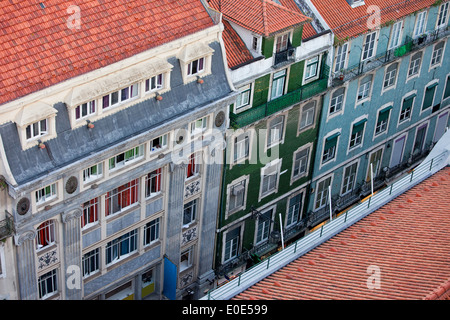 Old apartment houses and tenement buildings in the Baixa district of Lisbon in Portugal, view from above. - Stock Photo
