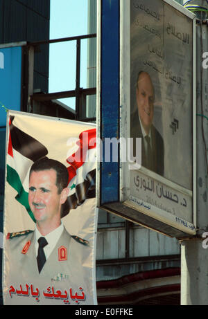 Damascus. 12th May, 2014. Photo taken on May 12, 2014 shows election posters in Damascus, Syria. A day earlier, - Stock Photo