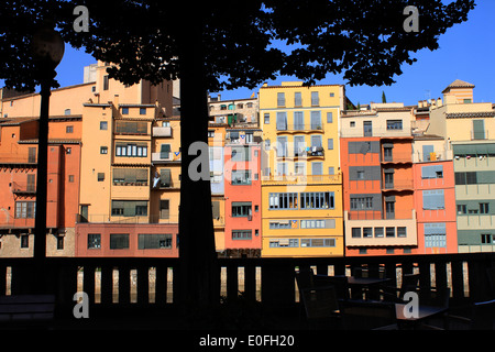 Orange and yellow coloured houses along the River Onyar in Girona, Catalonia, Spain - Stock Photo
