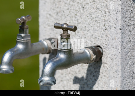 Outdoors water taps. Picture taken on a sunny day. - Stock Photo