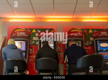 Fixed odds gaming machines in Ladbrokes Betting shop. UK - Stock Photo