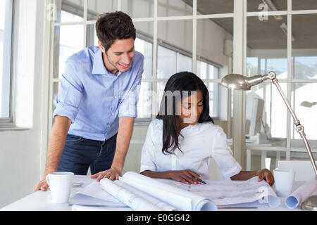 Architects working on important blueprints - Stock Photo