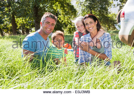 Family Having Fun On Camping Trip In Countryside - Stock Photo