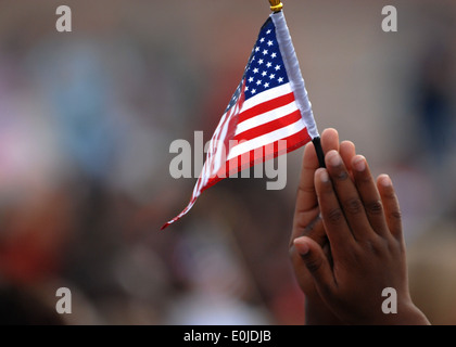 A student from Trimmier Elementary School waves his flag during a 9/11 remembrance ceremony, Sept. 10. The children - Stock Photo