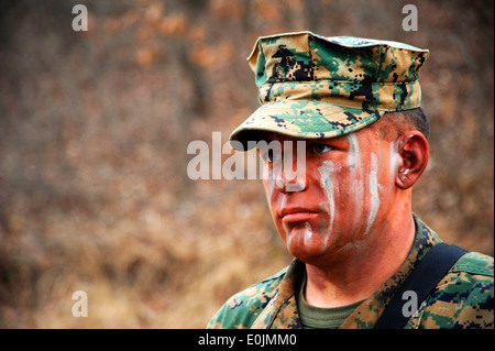 Cpl. Jacob Mills, assigned to 2nd Platoon, Fleet Antiterrorism Security Team Company Pacific, awaits further instruction - Stock Photo