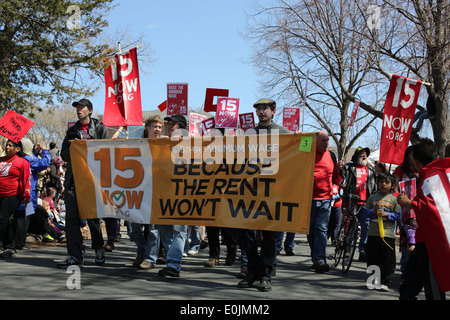 Protesters march for an increase in minimum wage. - Stock Photo