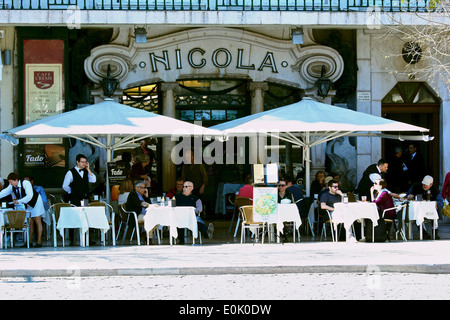 Alfresco cafe culture at busy Art Deco Nicola on Rossio Square (Praca Dom Pedro 1V) Lisbon Portugal western Europe - Stock Photo