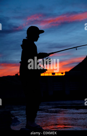 Boy fishing, Ohau Canal, Mackenzie Country, South Canterbury, South Island, New Zealand - Stock Photo