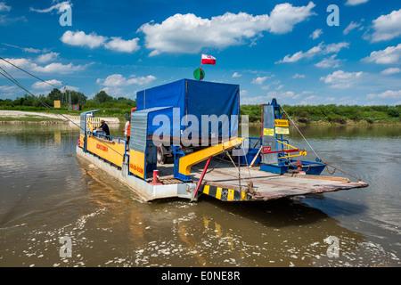 Local toll free two car cable ferry crossing Vistula river near Nowy Korczyn, Malopolska aka Lesser Poland region, - Stock Photo