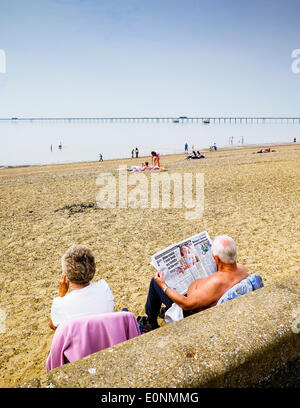 Southend on Sea, Essex, UK. 17th May, 2014.  People settle down in the morning on the Jubilee Beach at Southend - Stock Photo