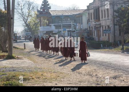 Monks collecting alms, Kalaw, Myanmar - Stock Photo