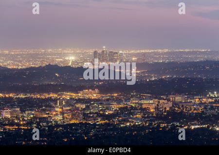 Hazy dusk nightfall above Pasadena and Downtown Los Angeles. - Stock Photo