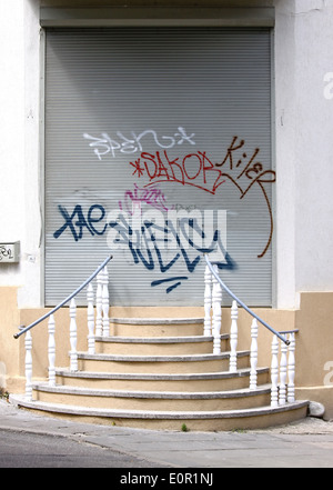 Grunge entrance with stairs and graffiti - Stock Photo