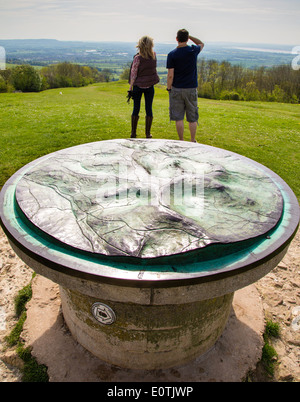 A couple looking out from the Topograph near Haresfield Beacon on the Cotswold Way near Stroud in Gloucestershire - Stock Photo