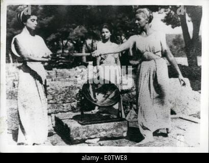 Aug. 08, 1960 - The Olympic Torch is on its way. Greek Girls as Ancient Priestesses: The Olympic flame was rekindled - Stock Photo
