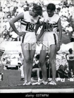 Aug. 08, 1960 - Olympic Games in Rome. Mary Bignal fails in Long Jump.: Photo shows Mary Bignal left confers with - Stock Photo