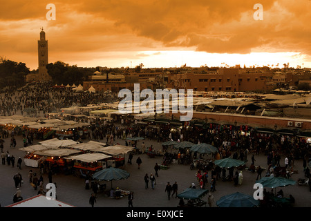 Jamaa el Fna,the main square in Marrakesh,Morocco.On background the Koutoubia mosque - Stock Photo