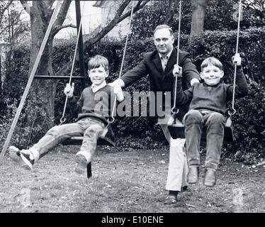 Aug 08, 1972 - Belfast, Northern Ireland, United Kingdom - WILLIAM CRAIG at home in the backyard pushing his two - Stock Photo