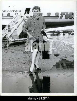 Feb. 24, 2012 - Idlewild Airport, N.Y., June 20 --- The Dancing Feet of Carol Haney are about to get wet prior to - Stock Photo