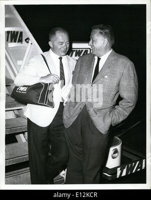 Feb. 24, 2012 - Idlewild Airport, N.Y., -- Leland Hayward, right and Billy wilder, pause on Completion of the first - Stock Photo