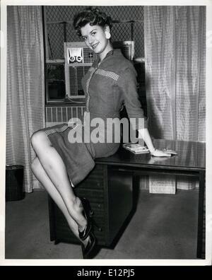 Feb. 24, 2012 - Idlewild Airport, N.Y., April 3 - Beverly Adland, 20th Century Fox Starlet, Boards A TWA Super G - Stock Photo