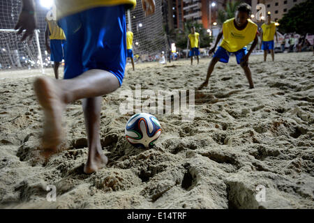Young people playing football in the evening at the beach, Praia de Iracema, Fortaleza, Ceará, Brazil - Stock Photo