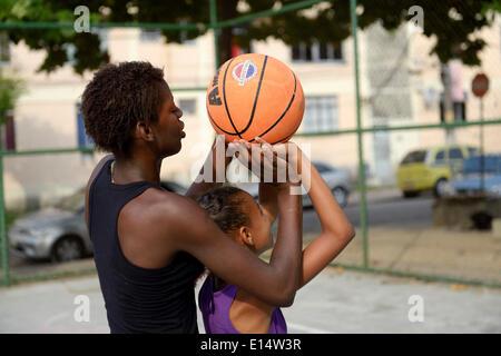 Two girls, 15 and 10, training basketball, Rio de Janeiro, Rio de Janeiro State, Brazil - Stock Photo