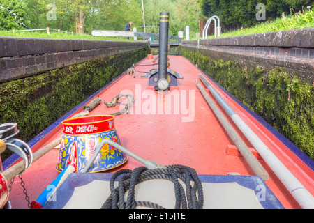 Traditional narrow boat working through a canal lock on the Staffs & Worcs Canal - Stock Photo